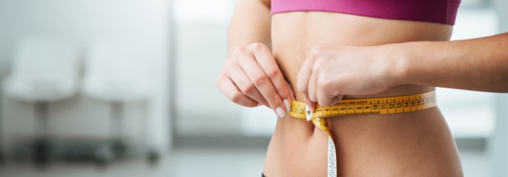 Woman Measuring Her Stomach After Weight Loss